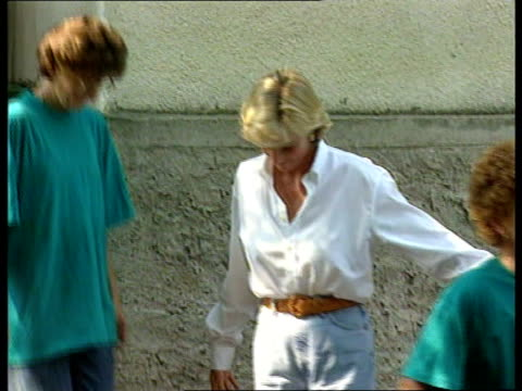 princess diana visits landmine victims; copyright itn-sky pool: bosnia: unknown location: princess diana out of house followed by two landmine victim... - bosnia and hercegovina stock videos & royalty-free footage