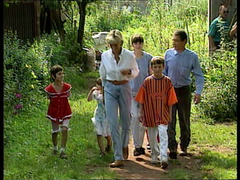 conflict princess diana visits landmine victims dobrinja princess diana with young children of landmine victim mohamed soljankic mohamed soljankic... - embracing stock videos & royalty-free footage