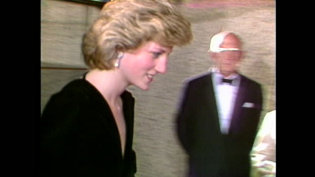 princess diana, wearing a black evening gown, is given flowers by a young girl and greeted by trevor nunn, as she attends a performance of les... - twilight stock videos & royalty-free footage