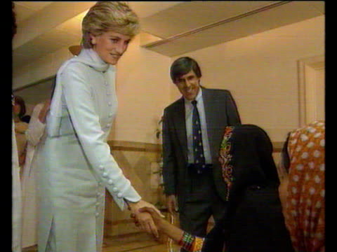 Princess Diana wearing full length gown greets women in wheelchair at hospital Lahore 22 Feb 96