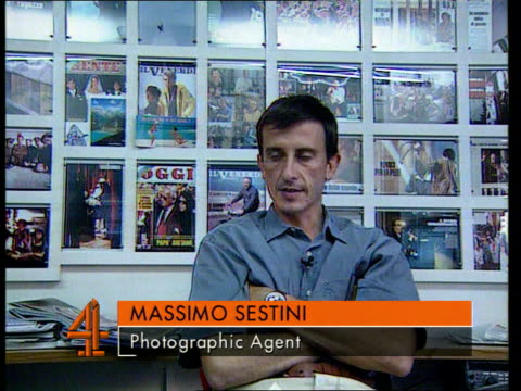 princess diana's death privacy laws itn massimo sestini seated at desk talking on phone and intvw we had photos of couple leaving sardinia/ couple... - crumpled paper stock videos and b-roll footage