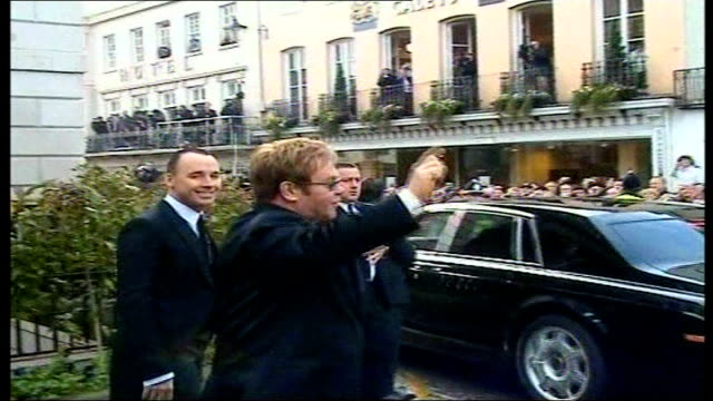 Princess Diana's sons plan concert to mark tenth anniversary of her death R21120510 Windsor Guildhall Elton John and David Furnish arriving for civil...