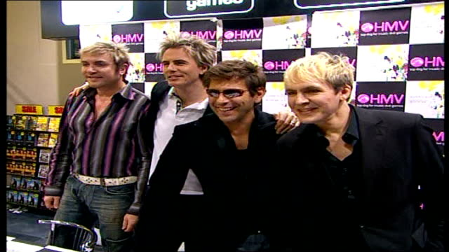 stockvideo's en b-roll-footage met princess diana's sons plan concert to mark tenth anniversary of her death date int duran duran band members posing for photocall in hmv * * flash... - duran duran