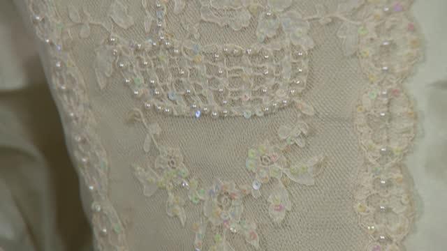 princess diana's wedding dress on display at kensington palace; england: london: kensington palace: int various of dress designed by emanuel and worn... - news not politics stock videos & royalty-free footage
