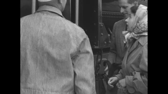 princess elizabeth and prince philip duke of edinburgh walk alongside train / elizabeth and philip shake hands with engineer / tail of elizabethís... - landscape scenery点の映像素材/bロール