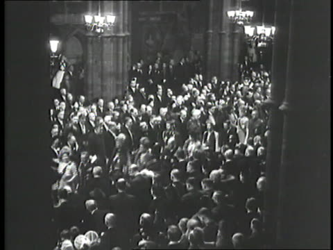princess elizabeth and prince philip walk hand in hand followed by their wedding party during the ceremony in westminster abbey - elizabeth ii stock videos & royalty-free footage