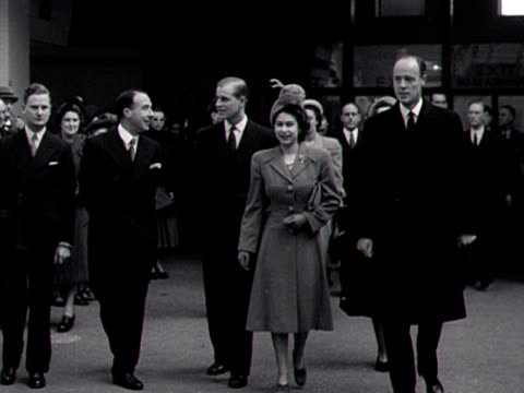 princess elizabeth and the duke of edinburgh walk into olympia for the ideal home exhibition 1948 - duke of edinburgh stock videos and b-roll footage