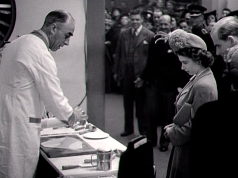 princess elizabeth and the duke of edinburgh watch as a man demonstrates pastry cutters on a stall at the ideal home exhibition 1948 - appliance stock videos and b-roll footage