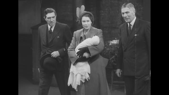 princess elizabeth carries baby princess anne as she walks on platform of train station, speaking with officials; she is headed for scotland for... - british royalty stock videos & royalty-free footage