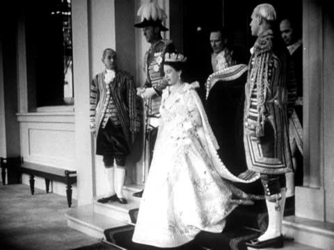 princess elizabeth leaves buckingham palace and walks to the gold state coach on her coronation day 1953 - buckingham stock videos & royalty-free footage