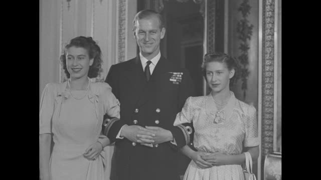 princess elizabeth, philip mountbatten, and princess margaret pose for photos in buckingham palace / note: exact day not known - prince stock videos & royalty-free footage