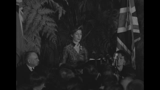 princess elizabeth speaks from lectern british and us flags on podium backs of heads in foreground my husband and i thank you for this welcome to... - 1951 bildbanksvideor och videomaterial från bakom kulisserna