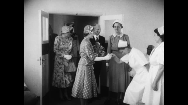 princess elizabeth, touring hospital with nairobi mayor j. r. maxwell, his wife, and other dignitaries, enters ward; nurses curtsey and shake her... - journey stock videos & royalty-free footage