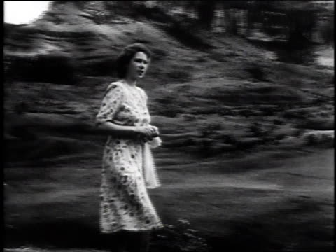princess elizabeth walking in countryside and speaking to camera / london, united kingdom - anno 1947 video stock e b–roll