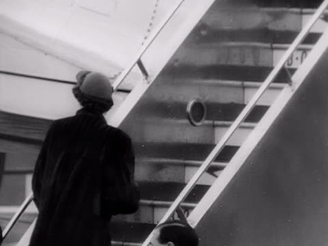 princess elizabeth walks up the stairs to a passenger aircraft and waves to the crowds prior to her tour of the commonwealth king george vi waves to... - british empire stock videos & royalty-free footage