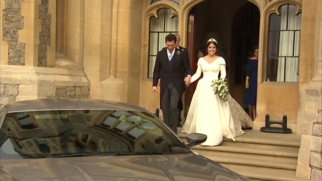 princess eugenie and jack brooksbank wedding: couple depart reception in aston martin; england: berkshire: windsor: windsor castle: ext prince... - princess stock videos & royalty-free footage