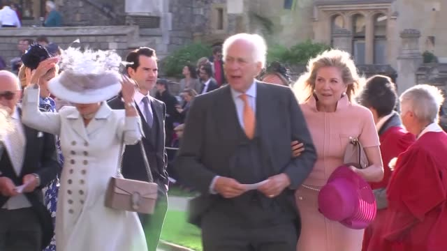 princess eugenie and jack brooksbank wedding guest arrivals england berkshire windsor windsor castle guests arriving at wedding and along into st... - st. george's chapel stock videos and b-roll footage