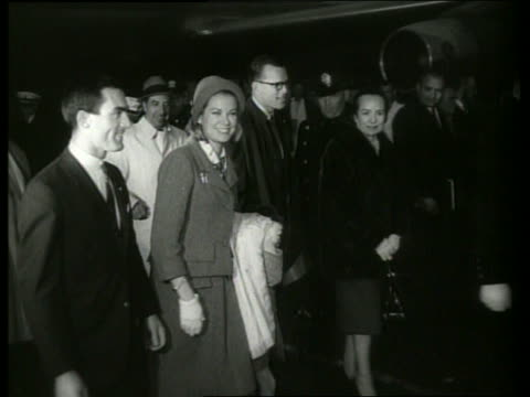 b/w princess grace and prince albert arrive ny airport / 1960s / sound - grace kelly actress stock videos & royalty-free footage