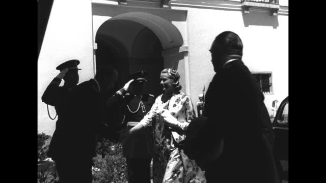 vídeos de stock e filmes b-roll de princess grace and rainier iii decar at the royal palace of el pardo for courtesy visit to spain's generalissimo francisco franco; officials greet... - 1950