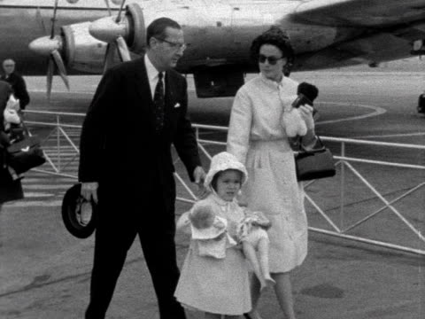 princess grace of monaco and her children walk past photographers and journalists at london airport and into a waiting car 1961 - monaco stock-videos und b-roll-filmmaterial