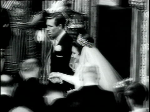 stockvideo's en b-roll-footage met princess margaret and antony armstrongjones exit westminster abbey after getting married / they leave in horse drawn royal carriage / couple emerges... - prinses margaret windsor gravin van snowdon