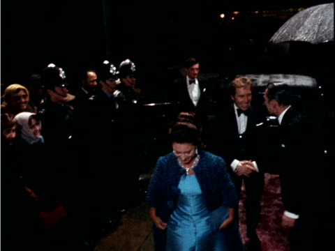 stockvideo's en b-roll-footage met princess margaret and lord snowdon arrive at the drury lane theatre for the official opening of the musical mame 1969 - prinses margaret windsor gravin van snowdon