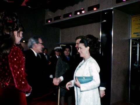 princess margaret and lord snowdon arrive at the odeon cinema in leicester square for the premiere of the film funny girl. 1969. - odeon cinemas点の映像素材/bロール