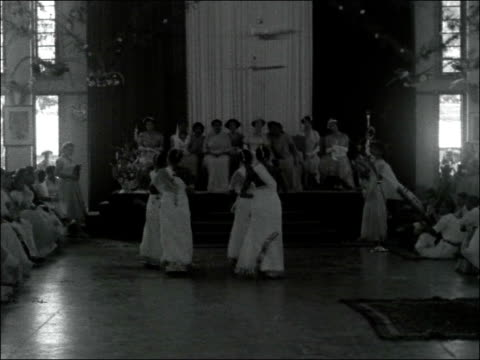 princess margaret arrives in mombasa kenya mombasa int guests around tables in large hall / various shots women performing traditional dance before... - princess margaret 1950 stock videos and b-roll footage