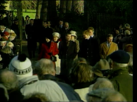 Bad health continues LIB Norfolk Sandringham Members of Royal family towards Queen Mother down step as as watched by her daughter Queen Elizabeth II...
