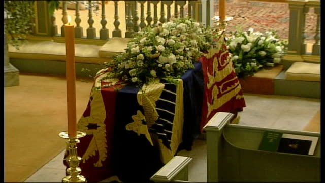 coffin in queen's chapel england london st james's palace coffin draped in royal standard topped with flowers standing on plinth before altar in... - death stock videos & royalty-free footage