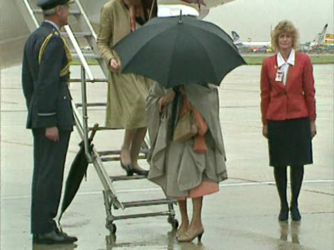 stockvideo's en b-roll-footage met princess margaret departs aircraft after flight into heathrow from balmoral follows queen who has already departed largely hidden by umbrella... - prinses margaret windsor gravin van snowdon