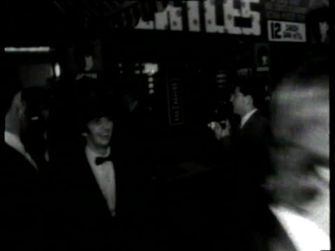 princess margaret departs 'hard day's night' premiere / the beatles departure fans being carried off by police fans being held back by police /... - film premiere stock videos & royalty-free footage