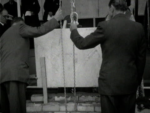 princess margaret helps to lay the foundation stone of a new church in borehamwood. - ボーハムウッド点の映像素材/bロール