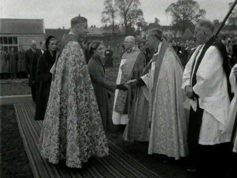 princess margaret is introduced to various religious dignitaries during her visit to a housing estate in borehamwood - princess margaret 1950 stock videos and b-roll footage