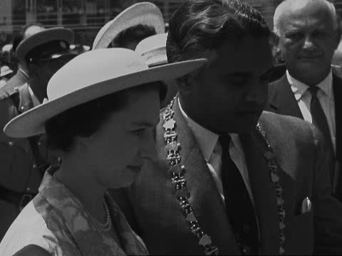 princess margaret lays foundation stone for new town hall; trinidad: port of spain: ext platform and party and crowd mayor speaking - princess... - sleeveless top stock videos & royalty-free footage
