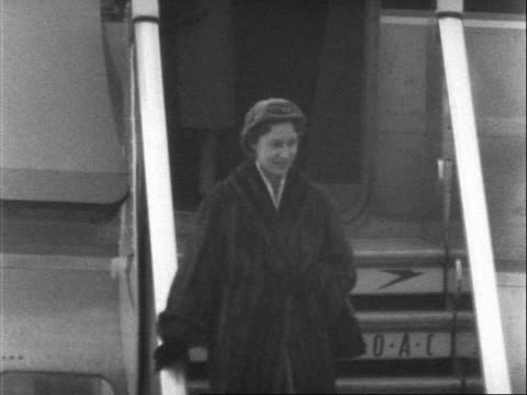 stockvideo's en b-roll-footage met princess margaret leaves the boac aircraft at london airport after returning home from her tour of the west indies. 1955. - winterjas