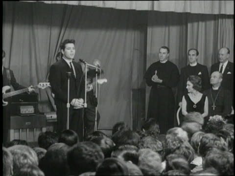 stockvideo's en b-roll-footage met princess margaret of britain waves as she walks on a stage then sits listening with clergymen as cliff richard performs - prinses margaret windsor gravin van snowdon