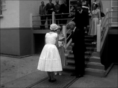 vídeos y material grabado en eventos de stock de princess margaret on tour of east africa mauritius flacq ext school children waving union jack flags / various shots princess margaret being shown... - 1956