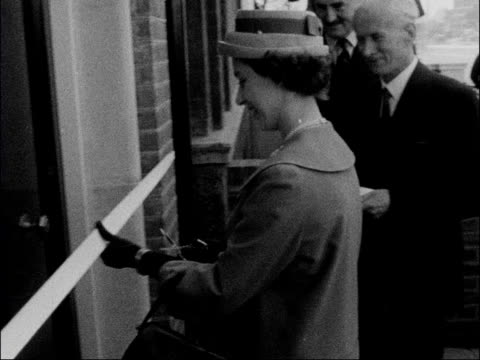 princess margaret opens new royal ballet school england london barons court ext princess margaret arrives greeted by dame ninette de valois and... - 1950 1959 stock videos & royalty-free footage