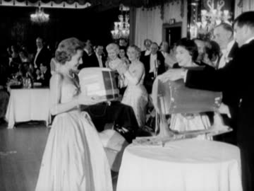 princess margaret presents tombola prizes to guests at a halloween ball at the dorchester hotel. 03 november 1957. - raffles city stock videos & royalty-free footage