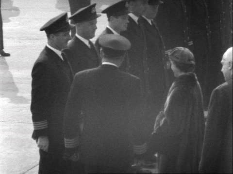 princess margaret prince charles and princess anne shake the hands of the pilots and cabin crew of the aircraft which brought margaret back to london... - captain stock videos and b-roll footage