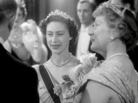 princess margaret talks to some guests at the royal opera house for the gala premiere of benjamin britten's new opera - gloriana. 1953. - tiara stock videos & royalty-free footage