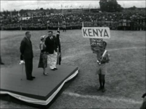 nairobi visit kenya nairobi ext children waving flags to greet hrh princess margaret at nairobi sports stadium / princess arrives / various shots... - kenyan flag stock videos & royalty-free footage