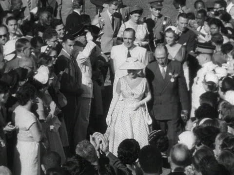 princess margaret walks through the crowds at knutsford park racecourse during her tour of jamaica - bbc archive stock-videos und b-roll-filmmaterial