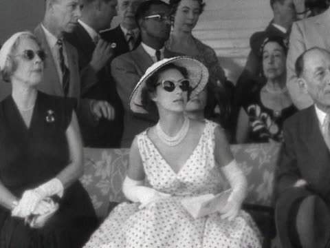 Princess Margaret watches a horse race at Knutsford Park racecourse during her tour of Jamaica