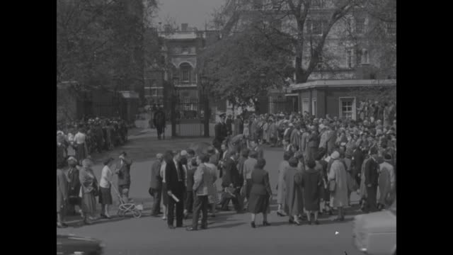 princess margaret's wedding eve; itn england: ext crowds in mall: tony at clarence house - arts culture and entertainment stock videos & royalty-free footage