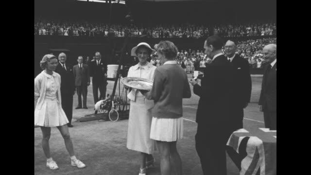 Princess Marina Duchess of Kent hands trophy to Louise Brough winner of Wimbledon women's singles championship / CU Brough and opponent Beverly...