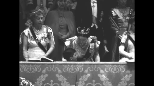 princess mary, elizabeth the queen mother, and princess margaret stand in royal box with young prince charles at the coronation ceremony of queen... - archbishop of canterbury stock videos & royalty-free footage