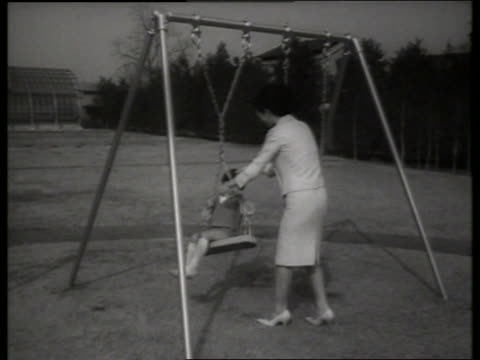 b/w princess michiko and prince hiro of japan at swings / 1960's / sound - japanese royalty stock videos and b-roll footage