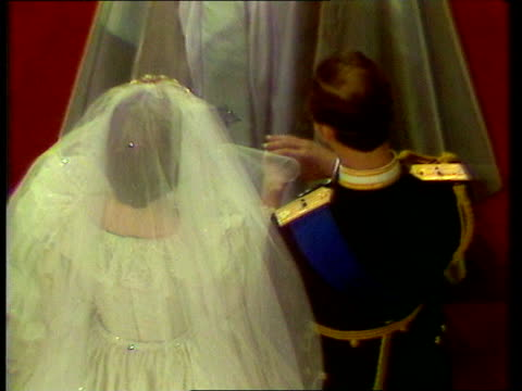 Princess of Wales agrees to divorce NAT London St Pauls SEQ Charles and Diana at altar as Diana takes vows EXT LMS Both towards out of church MS Both...